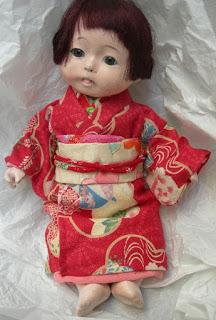 bambole con kimono
